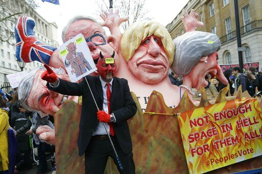 Effigies of British Prime Minister Theresa May and Conservative politicians Boris Johnson and Michael Gove, from right, and displayed during a Peoples Vote anti-Brexit march in London, Saturday, March 23, 2019. Anti-Brexit protesters swarmed the streets of central London by the tens of thousands on Saturday, demanding that Britain's Conservative-led government hold a new referendum on whether Britain should leave the European Union.