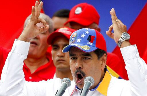 Venezuela's President Nicolas Maduro speaks during an anti-imperialist rally for peace, in Caracas, Venezuela, Saturday, March 23, 2019. The U.S. withdrew all embassy personnel from Caracas due to safety concerns after Maduro severed ties with the U.S. over its support for opposition leader Juan Guaido.