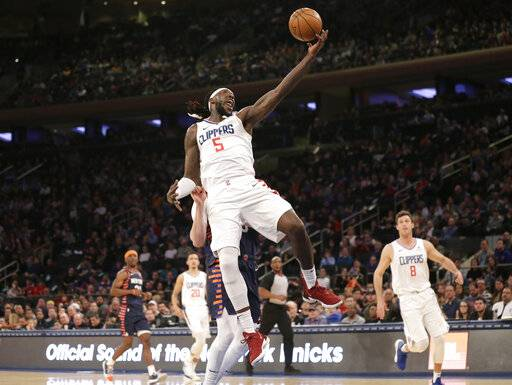 Los Angeles Clippers forward Montrezl Harrell (5) grabs a high pass during the first half of an NBA basketball game against the New York Knicks, Sunday, March 24, 2019, in New York.