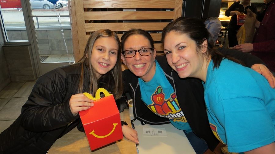 Field Elementary fourth grade student Emily Rude smiles with teachers Natalie Furfaro and Vicki Moran during the Third Annual Field School McTeacher's Night held on March 20th at the Wheeling McDonald's.Julie Travers