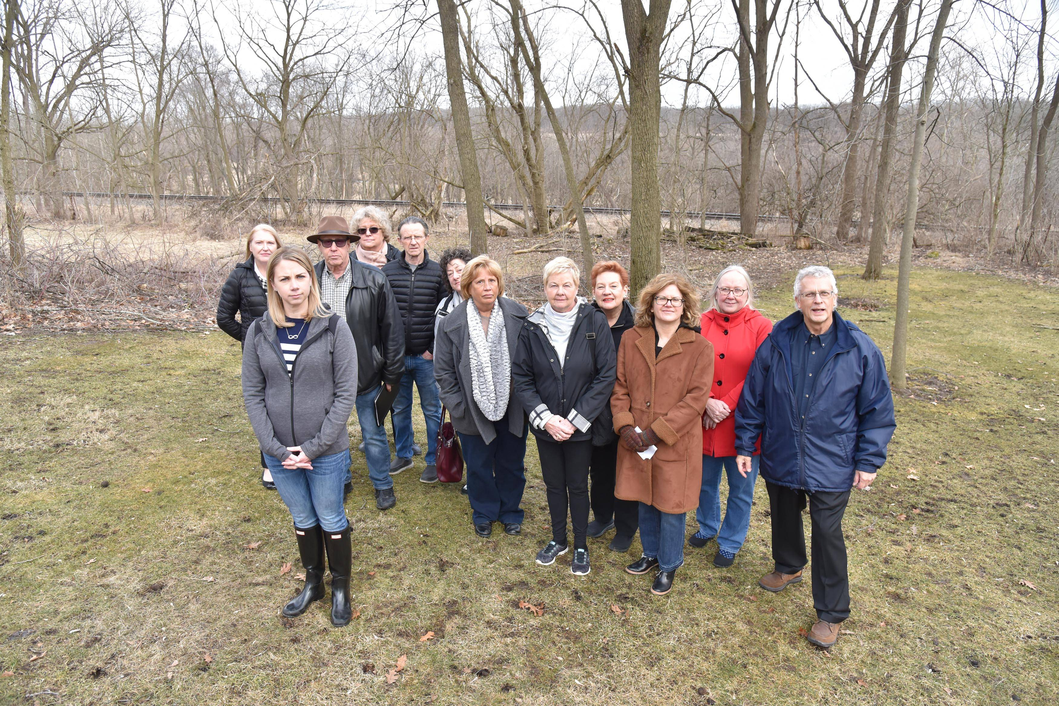 Amy Fields, front left, and her neighbors near Elgin don't want another set of railroad tracks in their backyards. The CN railroad tracks wants to add a second track, which it says will reduce freight and commuter train delays.