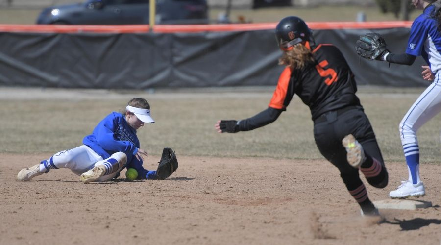 Burlington Central's Hanaa Nkhikhssi tries to find the ball as St. Charles East's Madelynn Stout reaches second base safely Monday in St. Charles.