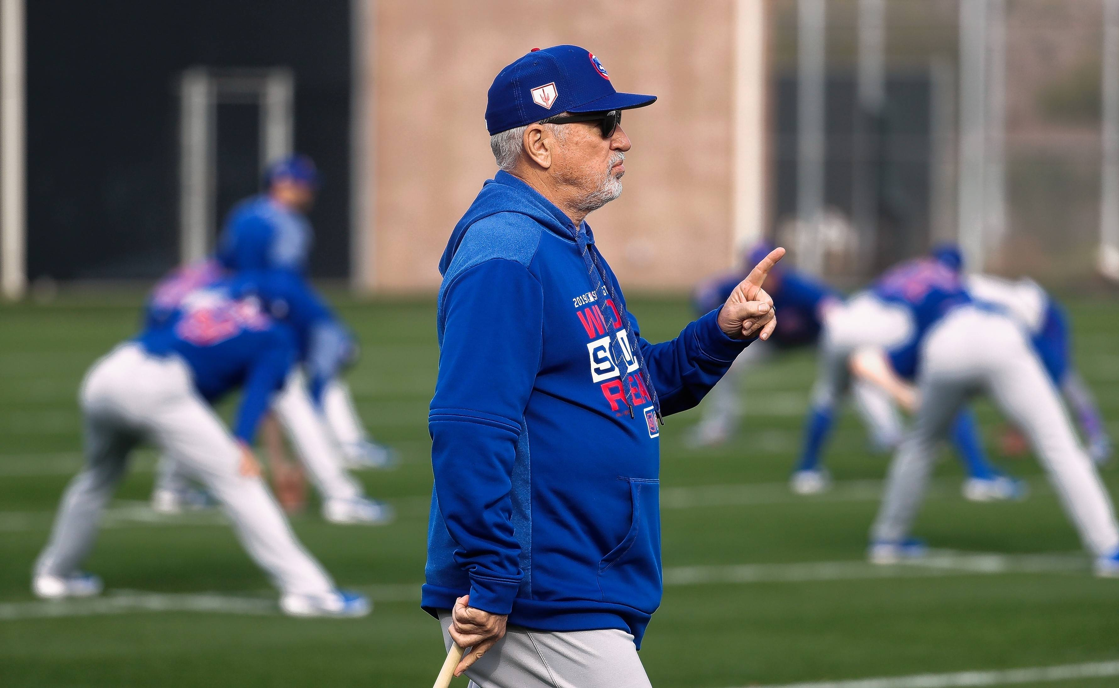 FILE - In this Feb. 15, 2019, file photo, Chicago Cubs manager Joe Maddon watches during a spring training baseball workout, in Mesa, Ariz. Depending on how you look at it ,Maddon is either on the hot seat as a lame-duck manager or in the catbird seat as a potential free-agent manager.