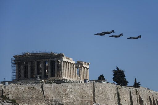 Military aircraft fly over the temple of the Parthenon during a parade in Athens, on Monday March 25, 2019. The parade commemorates Greek Independence Day, which marks the start of the war of independence in 1821 against the 400-year Ottoman rule.