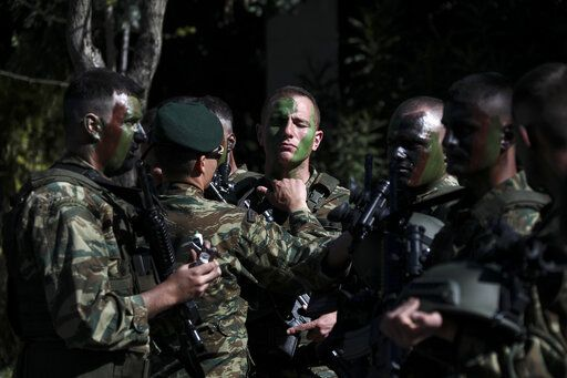 Army officers paint their faces ahead of a military parade in Athens, on Monday March 25, 2019. The parade commemorates Greek Independence Day, which marks the start of the war of independence in 1821 against the 400-year Ottoman rule.