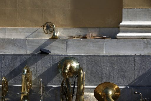 Musical instruments from a military band are placed against a wall ahead of a parade in Athens, on Monday March 25, 2019. The parade commemorates Greek Independence Day, which marks the start of the war of independence in 1821 against the 400-year Ottoman rule.
