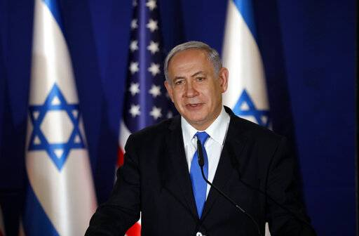 "Israeli Prime Minister Benjamin Netanyahu, speaks during a joint press conference with U.S. Secretary of State Mike Pompeo, at Netanyahu's official residence in Jerusalem, Thursday March 21, 2019. Netanyahu has praised U.S. President Donald Trump's recognition of its control over the Golan Heights as a holiday ""miracle.""  (Amir Cohen/Pool via AP)"
