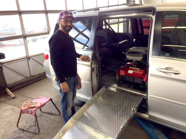 Midas Crystal Lake franchise owner Sam Khaira and his crew installed a wheelchair ramp in Henry Owens' donated Honda Odyssey van so he could get in and out easily. This week, they will install hand controls so Owens can drive.