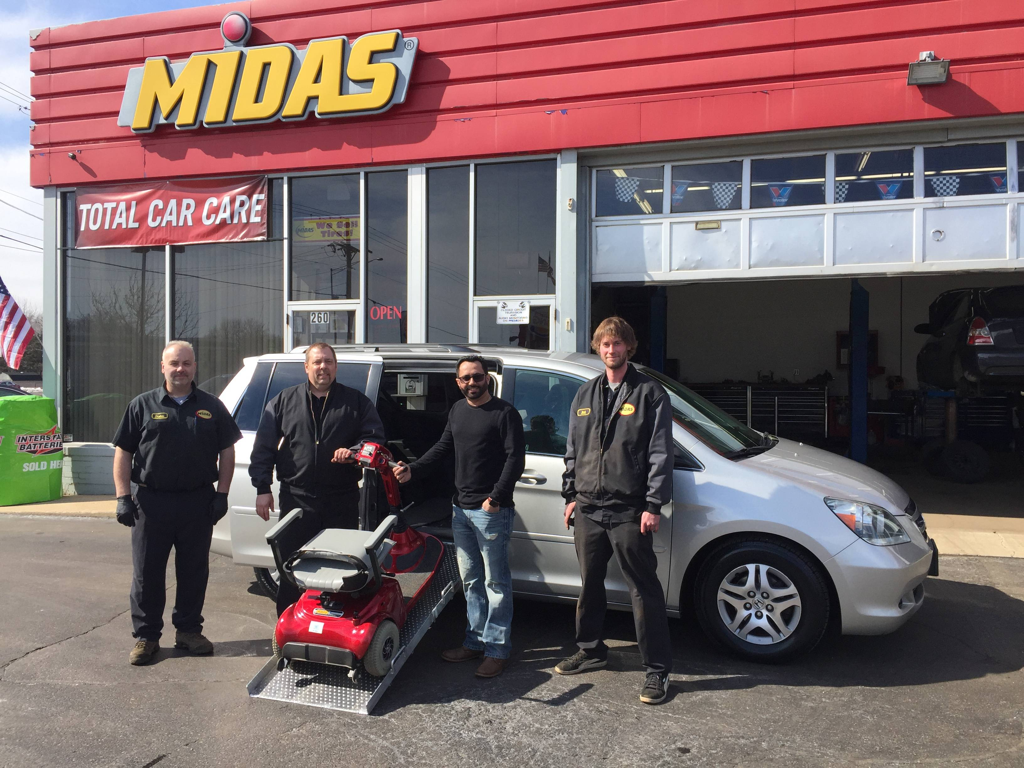 Midas Crystal Lake provided the free labor to install new tires, brakes, drivetrain and suspension parts for Henry Owens' van. Franchise owner Sam Khaira, second from right, and his crew also installed a wheelchair ramp so Owens can get in and out easily.