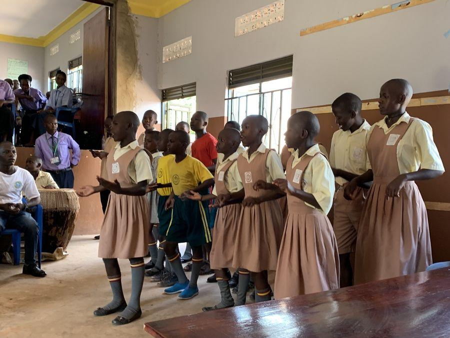 The students of St. Raphael School in Bunnamweri, Uganda perform for the visiting Rotarians on the day before work begins. The Rotarians were on a mission trip to install an aquaponics tank at the school for the purpose of harvesting tilapia.