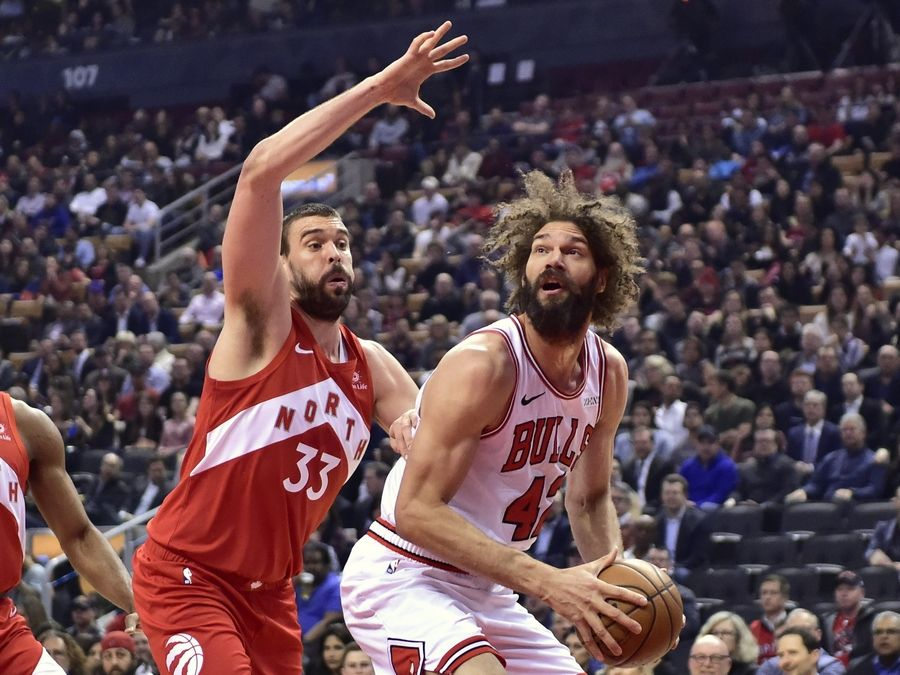Chicago Bulls center Robin Lopez (42) moves toward the basket as Toronto Raptors center Marc Gasol (33) defends during the first half of an NBA basketball game in Toronto on Tuesday, March 26, 2019. (Frank Gunn/The Canadian Press via AP)