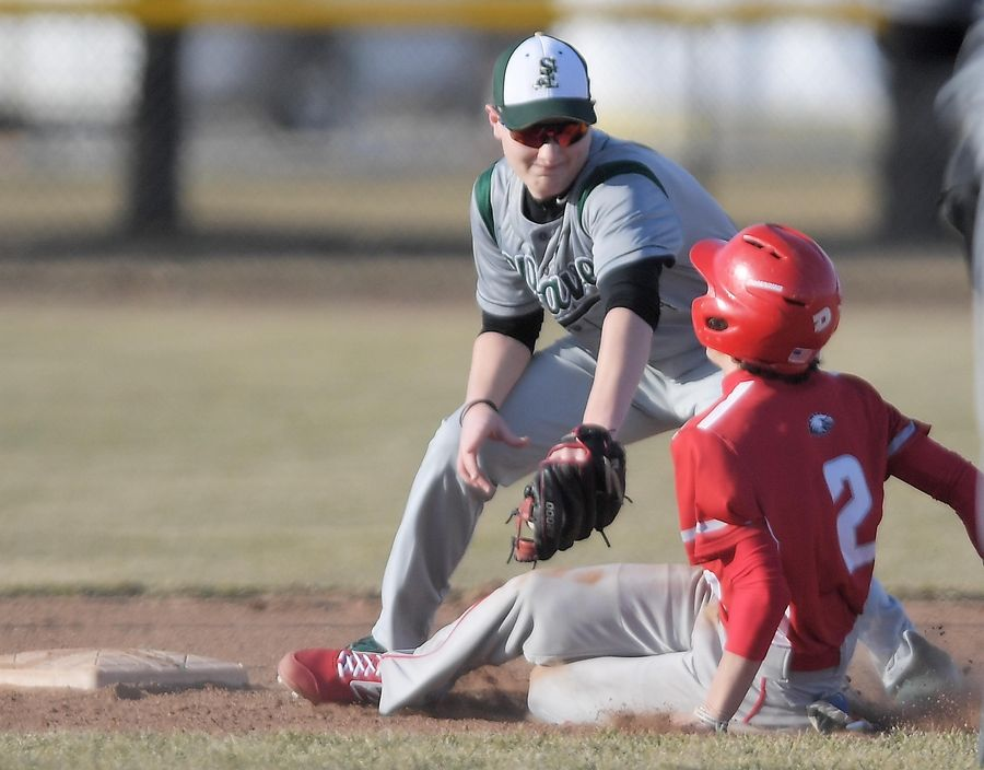 St. Edward's second baseman Andrew Tilche tags out Aurora Christian pinch runner Noe Marrero in a baseball game in Aurora Tuesday.