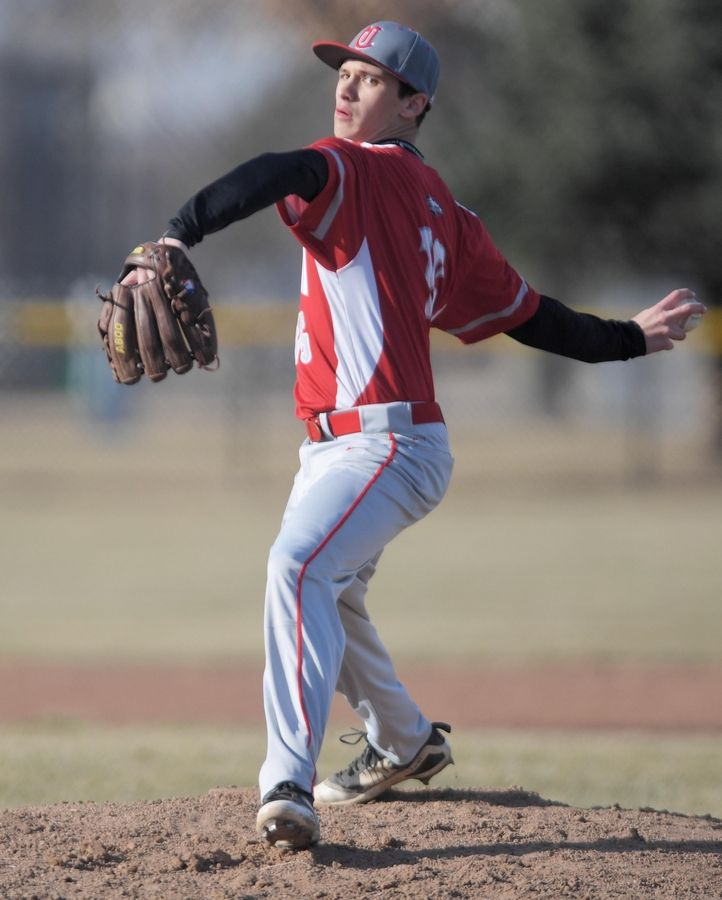 Aurora Christian's Hunter Thompson pitches against St. Edward in a baseball game in Aurora Tuesday.