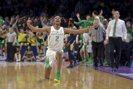 Oregon forward Louis King celebrates after scoring against UC Irvine during the second half of a second-round game in the NCAA men's college basketball tournament Sunday, March 24, 2019, in San Jose, Calif.