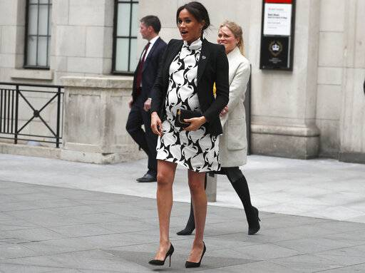 FILE - This March 8, 2019 file photo shows Britain's Meghan, the Duchess of Sussex, leaving King's College after joining a panel discussion to mark International Women's Day in London. With another royal baby on the horizon, the debate over postpartum perfection is alive and well. As it stands, we don't know whether Meghan Markle will follow in the footsteps of Kate Middleton when it comes to that magical perfection, but we have an inkling she'll at least slap on some makeup when she introduces the latest royal to the world next month. (AP Photo/Frank Augstein, File)