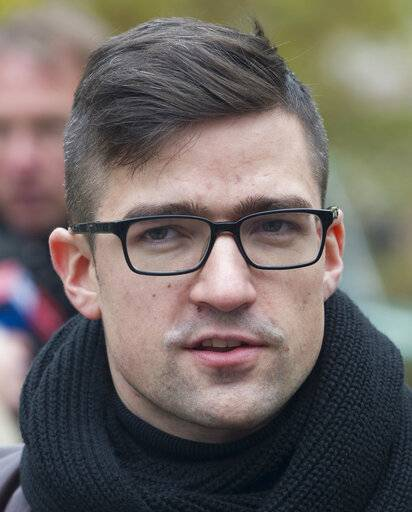 File--- In this picture taken Nov.5, 2016 Martin Sellner, leader of the right-wing populist Identitarian movement of Austria is seen giving an interview in Berlin, Germany. (Paul Zinken/dpa via AP)