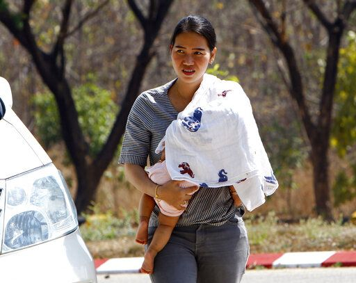 Pan Ei Mon, wife of Reuters journalist Wa Lone, carries her baby on arrival at the Supreme Court in Naypyitaw, Myanmar, Tuesday, March 26, 2019. Myanmar Supreme Court is expected to rule on appeal to overturn conviction of two Reuters journalists sentenced to seven years in prison on charges of violating Myanmar's Official Secrets Act.