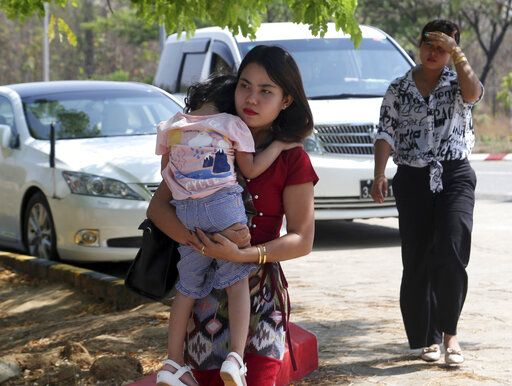 Chit Su Win, wife of Reuters journalist Kyaw Soe Oo, carries her daughter on arrival at the Supreme Court in Naypyitaw, Myanmar, Tuesday, March 26, 2019. Myanmar Supreme Court is expected to rule on appeal to overturn conviction of two Reuters journalists sentenced to seven years in prison on charges of violating Myanmar's Official Secrets Act.