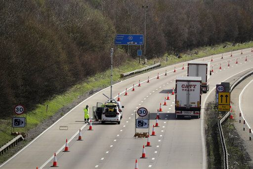 On the first day of Operation 'Brock', (Brexit Operations Across Kent) trucks pass through a contraflow system being tested on one side of the M20 motorway near Hollingbourne, Kent, in south east England, Monday, March 25, 2019. The contraflow is designed to manage queues of trucks heading to Europe, via ferries or the Eurotunnel to France, in the event of a no-deal Brexit, to prevent gridlock for other road users.