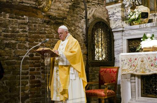 Pope Francis prays inside the shrine containing a small house traditionally venerated as the house of Mary, and believed miraculously transplanted from the Holy Land inside the Basilica of Our Lady of Loreto, in central Italy, where Francis is paying a one-day visit, Monday, Mar. 25, 2019. The pope chose Loreto to sign the Post-Synodal Exhortation of last October's Synod of Bishops.