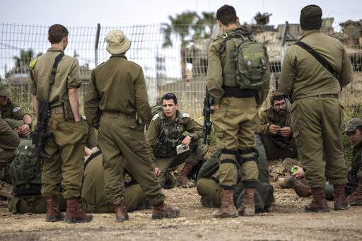 Israeli soldiers near the Israel Gaza border, Tuesday, March 26, 2019. A tense quiet took hold on Tuesday morning after a night of heavy fire as Israeli aircraft bombed targets across the Gaza Strip and Gaza militants fired rockets into Israel in what threatened to devolve into a major conflict, just two weeks before the Israeli election.