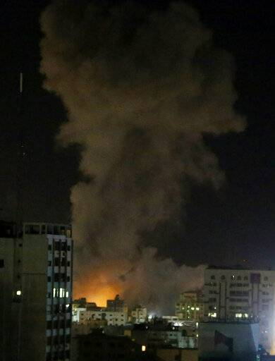 An explosion caused by Israeli airstrikes is seen in Gaza City, Monday, March 25, 2019. Israeli forces on Monday struck targets across the Gaza Strip in response to a surprise rocket attack from the Palestinian territory, as the military beefed up troops and rocket-defense systems in anticipation of a new round of heavy fighting with the Islamic militant Hamas group.