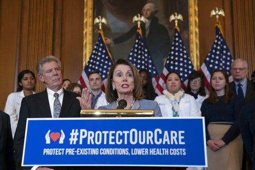 "Speaker of the House Nancy Pelosi, D-Calif., joined at left by Energy and Commerce Committee Chair Frank Pallone, D-N.J., speaks at an event to announce legislation to lower health care costs and protect people with pre-existing medical conditions, at the Capitol in Washington, Tuesday, March 26, 2019. The Democratic action comes after the Trump administration told a federal appeals court that the entire Affordable Care Act, known as ""Obamacare,"" should be struck down as unconstitutional."