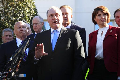 Rep. Rep. Steve Scalise, R-La., center, together with Rep. Kevin Brady, R-Texas, left, and Rep. Cathy McMorris Rodgers, R-Wa., right, and other Republican members of Congress speaks to reporters outside the West Wing of the White House following a meeting with President Donald Trump at the White House in Washington, Tuesday, March 26, 2019.