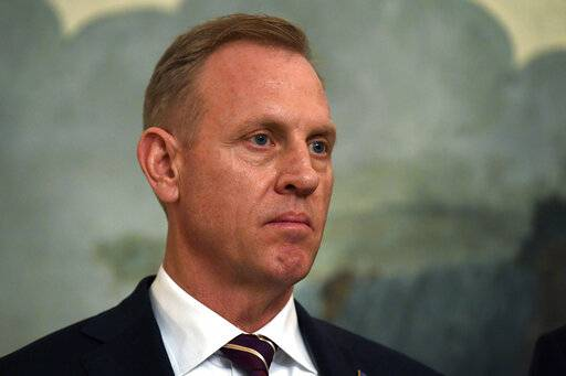 Acting Defense Secretary Patrick Shanahan listens during a proclamation signing with President Donald Trump and Israeli Prime Minister Benjamin Netanyahu in the Diplomatic Reception Room at the White House in Washington, Monday, March 25, 2019. Top defense leaders will face worried lawmakers on Capitol Hill for the first time since the Pentagon listed military construction projects that could lose funding this year to pay for President Donald Trump's border wall. (AP Photo/Susan Walsh)
