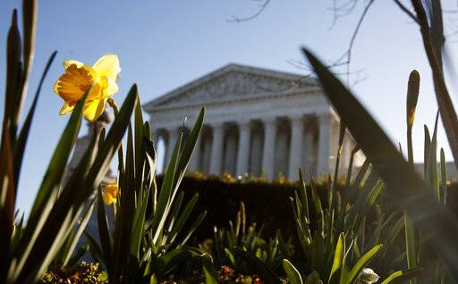 The Supreme Court building is seen on Capitol Hill in Washington, Tuesday, March 26, 2019. The Supreme Court is returning to arguments over whether the political task of redistricting can be overly partisan.