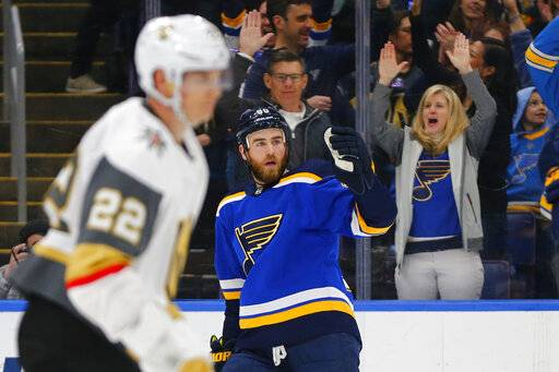 St. Louis Blues' Ryan O'Reilly (90) celebrates after scoring a goal against the Vegas Golden Knights during the second period of an NHL hockey game Monday, March 25, 2019, in St. Louis.