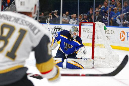 St. Louis Blues' goalie Jordan Binnington (50) makes a save against the Vegas Golden Knights during the first period of an NHL hockey game Monday, March 25, 2019, in St. Louis.