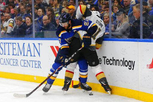 St. Louis Blues' Alex Pietrangelo (27) keeps Vegas Golden Knights' Mark Stone (61) off the puck during the first period of an NHL hockey game Monday, March 25, 2019, in St. Louis.