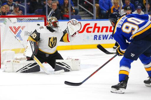 St. Louis Blues' Ryan O'Reilly (90) scores a goal against Vegas Golden Knights' goalie Malcolm Subban (30) during the second period of an NHL hockey game Monday, March 25, 2019, in St. Louis.