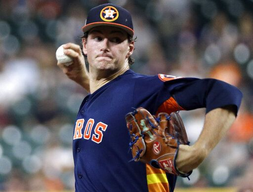 Houston Astros starting pitcher Forrest Whitley throws during the first inning of an exhibition baseball game against the Pittsburgh Pirates, Monday, March 25, 2019, in Houston.