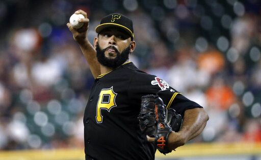 Pittsburgh Pirates starting pitcher Richard Rodriguez throws during the first inning of an exhibition baseball game against the Houston Astros, Monday, March 25, 2019, in Houston.