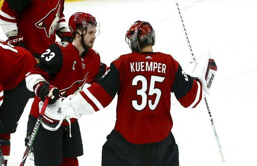 e42fd75ba8f Arizona Coyotes goaltender Darcy Kuemper (35) celebrates his shutout  against the Chicago Blackhawks with