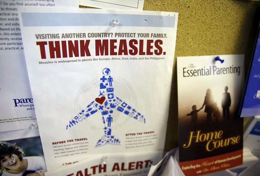 A flyer about the possibility of contracting measles while traveling is displayed at a clinic in Greenbrae, California.
