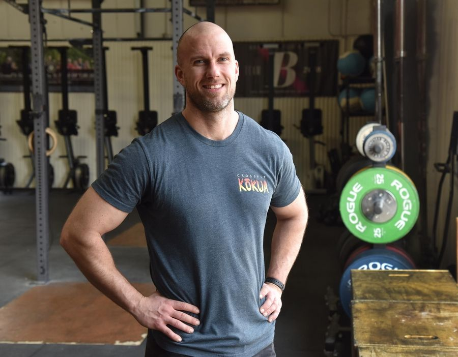 Joe Donar, 35, of Woodridge, tries to create a sense of community for his fellow veteran clients at CrossFit Kokua gym in Geneva.