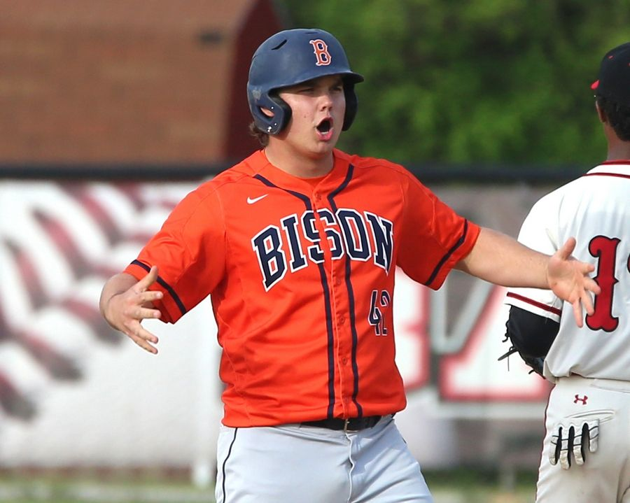 71920d449 Buffalo Grove s Riley Rundquist celebrates his arrival at second base with  a double against Barrington during