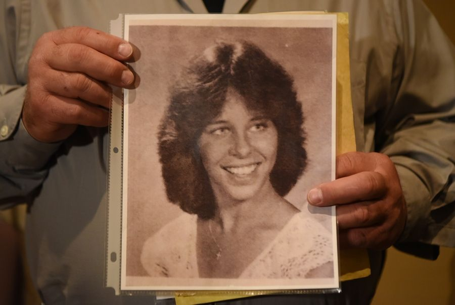 Mark Borowski holds a photo of his sister Lorry, who was murdered in 1982.