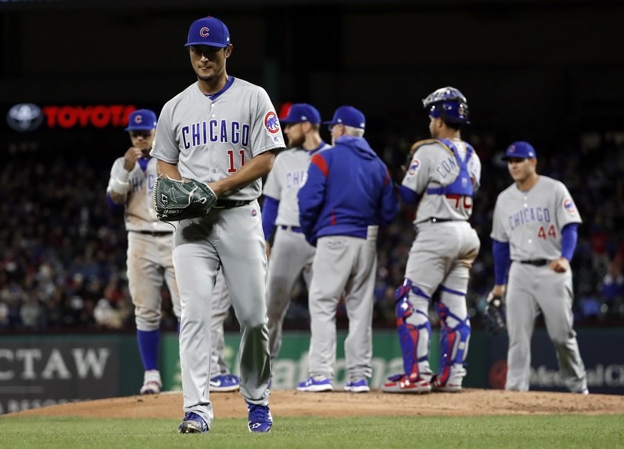 bb8990742 Chicago Cubs starting pitcher Yu Darvish (11) walks to the dugout after  being pulled