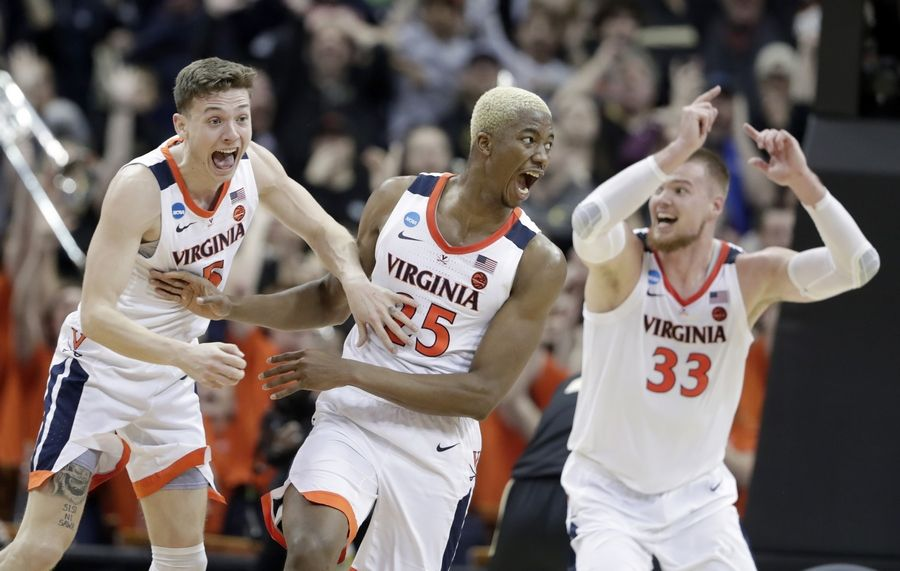 4b8d19e0fc0 Virginia shakes off Purdue to win in overtime