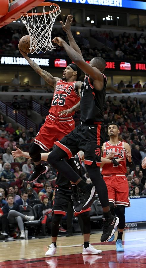 Chicago Bulls' Walter Lemon Jr. (25) goes up for a shot against Toronto Raptors' Serge Ibaka (9) of Spain, during the second half of an NBA basketball game Saturday, March 30, 2019, in Chicago. Toronto won 124-101.