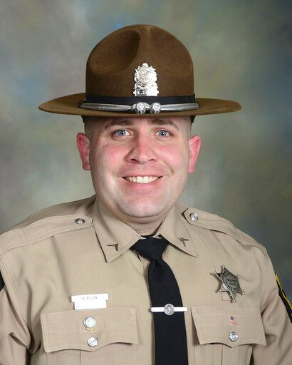 This photo provided by Illinois State Police shows Trooper Gerald Ellis.  Illinois State Police say Ellis was killed while on-duty in his squad car when he was struck by a vehicle traveling the wrong way on Interstate 94 in northern Illinois. State police say the 36-year-old Trooper was driving home when he was struck early Saturday, March 30, 2019. in Green Oaks, Ill. Police say the wrong-way vehicle was traveling eastbound in the westbound expressway lanes and struck Ellis' squad car head-on. (Illinois State Police via AP)