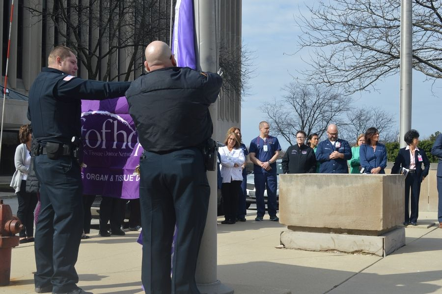 Team members at Advocate Good Samaritan Hospital in Downers Grove gather to raise a Gift of Hope flag April 1 for National Donate Life Month.