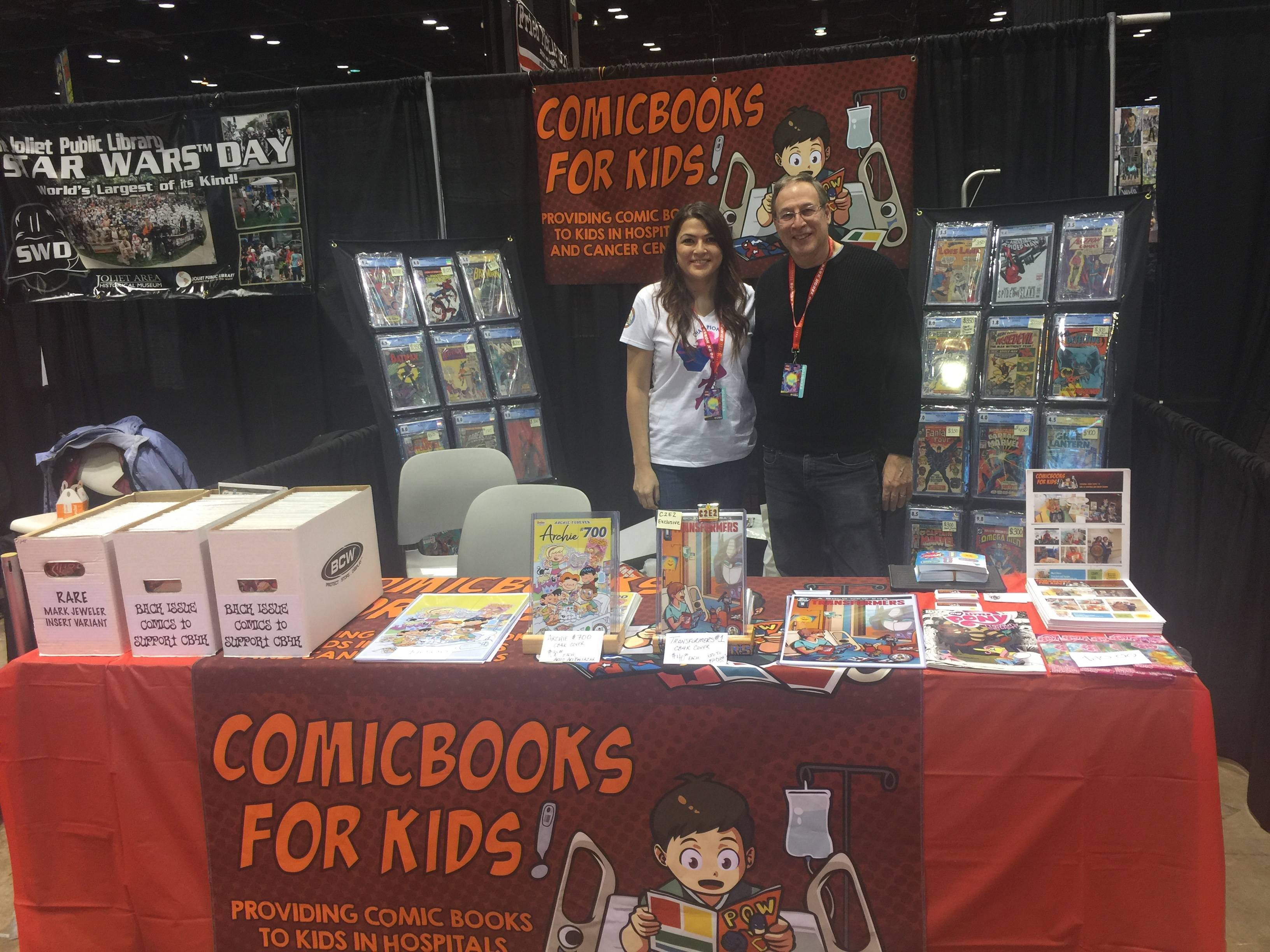 From left, Michelle Weiss, vice president of ComicBooks for Kids!, a St. Charles-based charity that distributes new comics to children in hospitals and cancer treatment centers, with her father Mark Weiss, founder of the nonprofit, at their booth at C2E2.