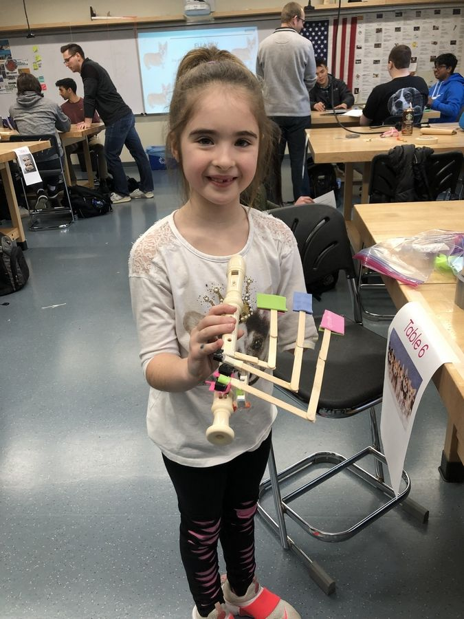 Ella Doloughty, 8, of Long Grove, was born without the lower part of one arm, which prompted Stevenson High School engineering students to design a solution for her to play the recorder.