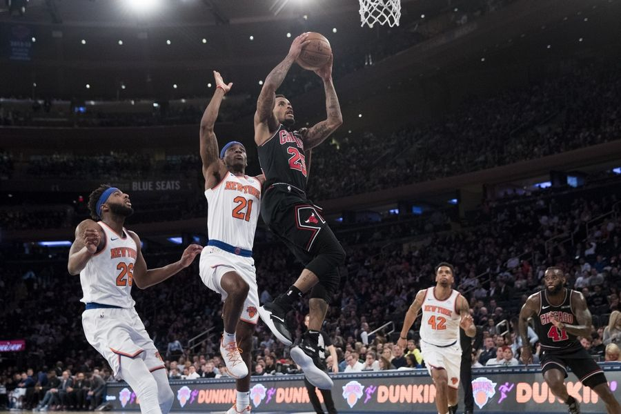 Chicago Bulls guard Walt Lemon Jr. (25) goes to the basket past New York Knicks guard Damyean Dotson (21) during the second half of an NBA basketball game, Monday, April 1, 2019, at Madison Square Garden in New York.