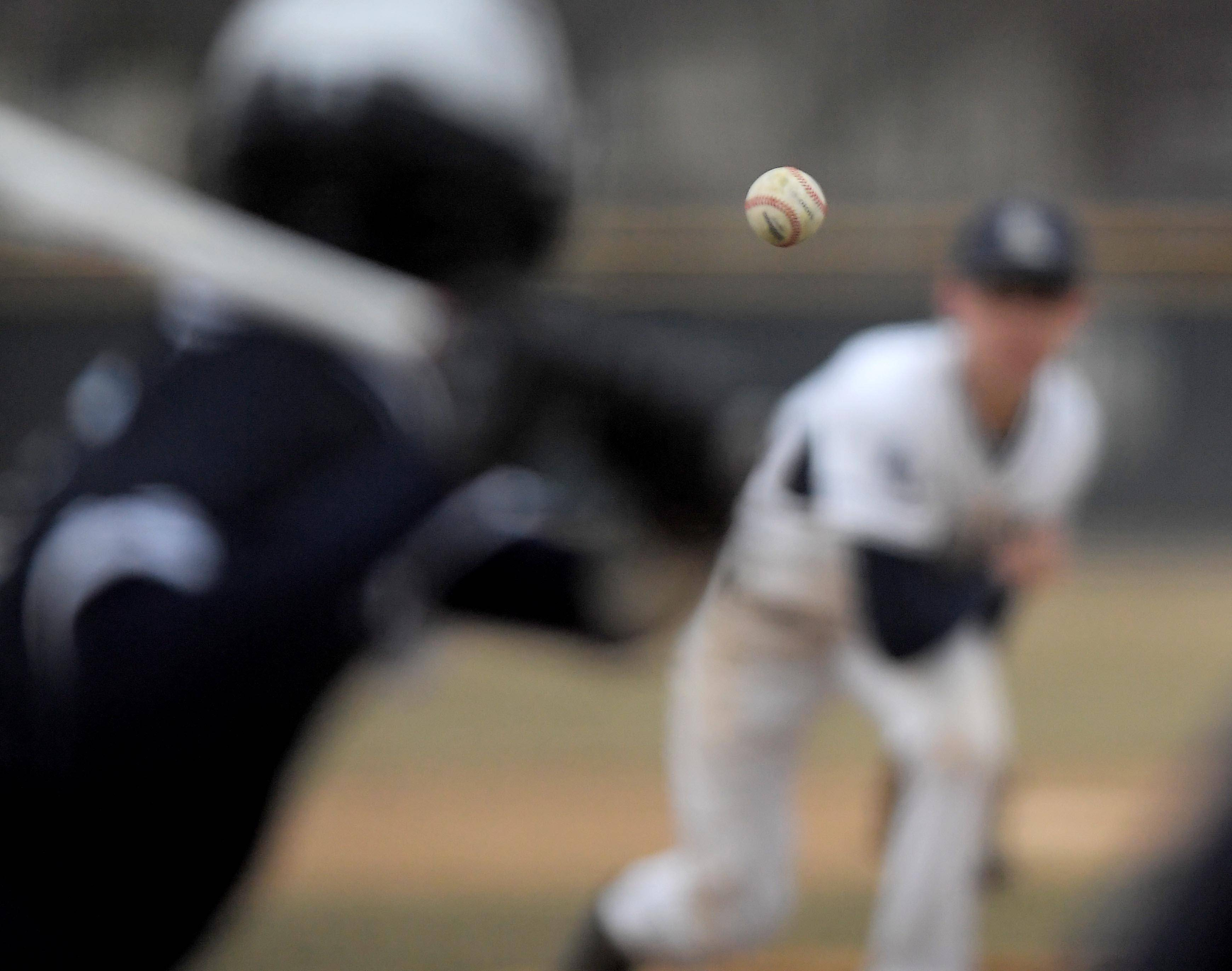 Lisle's Sam Russo pitches to a DePaul Prep batter in Lisle on Wednesday.